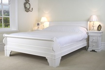 White Sleigh Bed Collection / This stunning white Sleigh bedroom collection is made from solid mahogany and is finished in a white semi-gloss paint finish. We are particularly proud of our New range of white French Sleigh Beds which contain superb craftmanship. All of the bedroom furniture have panelled sides and has a solid panelled backs, supported on a bracket feet. The drawers to all the chests also have dove tail joints.