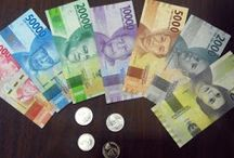 Uang Baru & Simbol Kesejahteraan