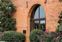 Our Property / Historic Smithonia Farm is an event venue comprised of 3 beautiful brick barns. They were built under the ownership on James Monroe Smith in 1888. Since then, they have undergone many different owners including the Tucker family, the famous Kenny Rodgers and now is owned by Pam NeSmith. We are thrilled to share with you our beautiful property for both weddings and events. If you are interested in hosting your next event or wedding, please email us at smithoniafarm@gmail.com.