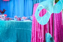 Masquerade 80th Birthday / A vivid colour palette of Turquoise, Teal + Magenta was carried throughout this Masquerade Event through ornately decorated masks, custom designed Props. Bright sequin linen dressed the dry bars and dessert table, complimented by black Baroque furniture to draw out the dramatic elements. Guests were able to treated to an array of delicious treats at the candy station, which featured theme candy and customised chocolate wraps. Youtube: https://www.youtube.com/watch?v=DbIY-kyrREE&feature=youtu.be