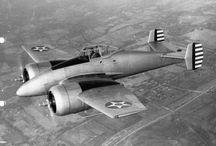XF 5F / It had several notable design features; among these, the pilot would operate the aircraft from a prone position, permitting the pilot to withstand much greater g-forces in the upward and downward direction with respect to the plane – and welded magnesium monocoque structure instead of riveted aluminum.