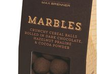 Max Does Marbles / Marbles are crunchy cereal balls rolled in hazelnut praline. Each bite is delectable with crunch and sweetness that will have you coming back for more.