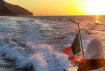 """LUXURY YACHT TRANSFERS AND EXCURSIONS / With our tours, spend your time  relaxing while we take care of all the details so you can experience the breathtaking Amalfi Coast and dine aboard our vessels or in a typical restaurant suggested by our skippers.  We offer shared and  private tours and excursions so you can discover the """"Pearls"""" of the Bay of Naples such as Capri, the Sorrento Coast, Ischia and Procida and also those of the Gulf of Salerno as well as Positano, Amalfi, Vietri, Maiori and Minori."""