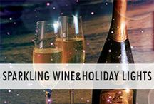 Sparkling Wine and Holiday Lights