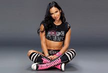 AJ Lee / @WWEAJLee / April Jeanette Mendez (born March 19, 1987)is an American professional wrestler. She works for WWE under the ring name AJ Lee, where she is the reigning WWE Divas Champion.