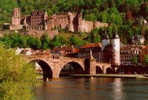 Beautiful Heidelberg / Heidelberg lies on the Neckar River at the point, where it leaves its narrow, steep valley in the Odenwald to flow into the Rhine valley where, 12 miles Northwest of Heidelberg, it joins the Rhine River at Mannheim. Heidelberg is part of a densely populated region known as the Rhein-Neckar-Triangle.