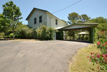 110 Keanahalululu Lane, Bastrop, Texas offered at $290,000 / Beautiful five bedroom home on 5 lots (approx. 1.7 acres) in Tahitian Village! Home features high & vaulted ceilings, game room, possible 2nd master bdrm upstairs, built-ins throughout, formal dining, fire place in family room, tons of storage & more! Kitchen boasts center island w/ cooktop & 17' vaulted ceiling. Master features double vanity, walk- in shower, large garden tub & walk-in closet. Wonderful covered back porch w/ hot tub and gazebo!