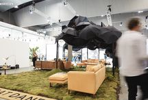 """DEN FAIR 2017 / Great Dane's award winning """"Best Stand"""" display at this year's Den Fair. A multi sensory experience complete with rain soundscape and real mossy hills. A whimsical outdoor library to escape away to amidst the excitement of the fair. We showcased our new leather range on Klassiks Sofas and the new Arne Jacobsen Bellevue Lamps from &tradition."""