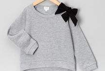 Grey black and white kiddies clothes.