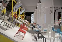 """""""Pedrali Mirror"""" stand 2013 / A meeting plaza where you can walk among products and novelties 2013. Along the sides of this """"promenade"""", portions of paving arise as an origami paper, folding up in unusual angles, whilst the mirrored surfaces give to the space a new dimension."""