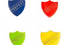 School Badges / We supply metal backed Enamel shields or bar badges and plastic backed safety pinned square badges to a large number of schools throughout the UK.  From Prefect and House Captain to Head girls and boys...  We have the colour and shape to suit your needs.  Check out our product line below.