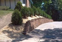 Retaining Walls / Retaining walls are carefully engineered to defy gravity and hold up soil in areas that would naturally slope downhill. The team at Groundworks has the experience to build an attractive wall that will retain the land for many years.