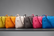 IRRESISTIBLE INTRECCIATO / For the finishing touches to enhance that effortless summer attitude, savor an exquisitely handcrafted selection of intrecciato nappa bags, wallets and more, in a range of colors that are sure to satisfy.