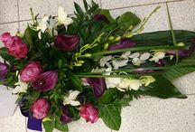 Pink and lilac funeral arrangements