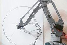 Robot / Especially shaped like a arm