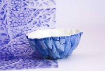 Blue Harvest / The Blue Harvest collection consists of bowls, dishes, and spoons of porcelain. They are made and colored by hand. The collection focuses on the beauty of our food, ever admired a cabbage? The fine structures and shapes accented by blue pigment play the main part in this collection.