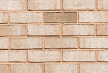 Stone Canyon   Triangle Brick Company / Inspired by the variations in color and texture found in our nation's awe-inspiring canyons, our Stone Canyon brick adds a striking, natural look to your project, featuring a pale sandstone-colored base accented by subtle oranges, grays and browns. This sand-faced brick is classified under Triangle Brick Company's Standard product tier, making it perfectly suited for a wide range of cladding applications.
