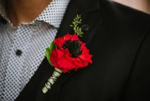 Boutonnieres: Red and Burgundy / Lovely red and burgundy boutonnieres. #boutonnieres #buttonholes #groom #groomflowers #wedding #redboutonniere #redbuttonhole #burgundyboutonniere #burgundybuttonhole