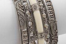 Silver and gold bracelets.