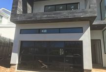 Black anodized aluminum frame with black glass garage door