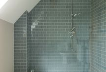 Shower room / I like the shelf in the false wall idea in this design.