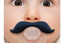 Mustache Pacifiers / Move over milk mustache, the fake mustache is officially a kid trend. Enjoy!