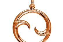 Maori Koru Collection / Based in nature, the Koru design comes from the spiral shape made by an uncurled silver fern frond. Before it uncurls new fronds are tightly spiraled in a round shape. The Maori Koru can have several meanings such as a new beginning, growth, and tranquility. These ideas convey to events with a positive change like weddings, new baby, or a new job