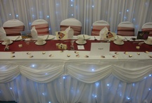 Neatly Seated / Neatly Seated is a wedding and venue design and decorating business. Chair covers, sashes, centrepieces, flowers, backdrops, swags.
