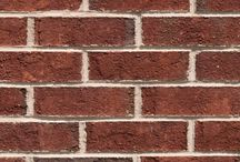 Oxford   Triangle Brick Company / Epitomizing small-town North Carolina, Oxford is home to blocks of turn-of-the-century brick houses and countless of other historic buildings, from an old courthouse to a 19th-century orphanage. Triangle Brick Company's sand-faced Oxford brick, offered under our Premium product tier, pays homage to this long-standing architecture with its rich, burgundy brick color, and deep red and brown overtones.