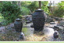 Stacked Slate Bubbling Urns / This is a collection of photos of installations of Aquascape's Slate stacked urn installations. Most of these installations are located in the Monmouth County NJ area. These bubbling urns can add a soothing spot in your gardens or landscaping, they also go great near the front door or entrance to welcome your guests. Three different sizes of these urns are available to fit every budget.