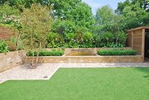 Wandsworth Common by Really Nice Gardens / We designed this Wandsworth garden to match the modern and classic fusion of the house. Features include a pond with running water and an artificial lawn.
