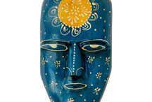 Wooden Masks / An explicit collection of varied hued hand carved hand painted wooden masks. Not to be found on your neighbour's wall, these masks are a perfect find for your search for an uncommon home decoration element. Gift your wall a wall hanging that will enhance it's beauty by a thousand times. Hanging machine made cheap wall hangings is out of fashion.