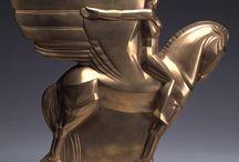art deco - secese - art nouveau / všechno, co člověk vytvořil ve tvaru a vzhledu odpovídajícím stylům art deco, secese či art nouveau a stylům příbuzným - budovy, interiéry, obrazy, šperky, užité umění, sklo a porcelán, artefakty, móda etc. - časově je sice základem období konce 19.st. a 1. poloviny 20. st., ale až do současnosti vznikají artefakty výrazně inspirované těmito styly i jejich repliky (nikoli podvodná falsa)