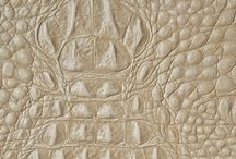Caiman / Bring your interiors to life with Garrett Leather's Caiman. The exotic, bold texture and beautiful depth of color invite you to engage and feel its superior quality. These whole hides have a dimensional pattern that begs to be touched, even when stretched over upholstered pieces. Whether specified for furniture, pillows, wall panels, or area rugs, Caiman adds life to any interior setting.  **Limited Editions collection. Please be sure to check inventory prior to placing your order.