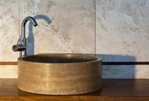 Bathroom Sinks / Stone bathroom sinks. Our sinks are carved from solid blocks of natural stone, marble or travertine. One of the main characteristics of Pietra di Rapolano stone are its particular veining patterns which make each and every piece unique. Natural stone sinks are decorative elements that add a special touch to the home: they are made to last for years because stone, like all natural materials, comes to life with use.