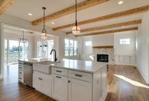 Open Floor Plan / Open floor plans offer flexible living and are great for every day living and entertaining.  Carbine & Associates has been creating gorgeous homes from French Manor and farmhouse to beautiful a Tuscan Manor.