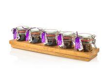 Theeplankjes / Onze weckpotjes vol premium kwaliteit losse thee op een handgemaakt eikenhouten plankje.