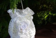 Pouches and bags made of lace