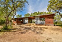 Inspiring Oaks / Completed Project located near Wimberley, TX. Two bedroom, one bath home with screened in porch, outdoor tub, and surrounding deck.