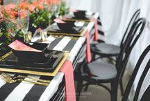 Coral + Monochrome Wedding Expo / This Spring inspired wedding theme with Bright, Fresh and Vibrant hues were used to compliment the bold black and white striped tablecloths and sleek black bentwood chairs. Our Graphics Department utilised this colour palette through watercolour textures and fun fonts, while our floral team used our beautiful custom made coral napkins as the base palette for their extravagant floral table runner. Youtube: https://www.youtube.com/watch?v=NA6AB0F3Sr8&feature=youtu.be