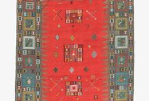 """Verneh / Verneh is a floor covering that originates in the Caucuses that used to be known as a """"sileh."""" Typically, it has two pieces connected in its center, and designs surrounded it with horizontal rows of squares, usually two or more per panel. In the mid-20th century, using the soumak technique, verneh were born from what were at the time just old kilims from the caucuses and now they represent a rich traditional and truly lovely pieces in and of themselves."""