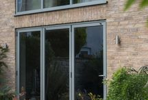 Bifold Doors / Bring the outside in with our aluminium bifold doors. Bifold Doors   Aluminium Bifold Doors   Bifold Door Colours   Bifold Door Ideas   Bifold Doors Kitchen   Bifold Door Blinds   Bifold Doors Onto Patio