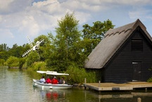 The Broads / A unique, flat landscape of meandering waterways and wide open spaces covered by East Anglia's famous broad blue skies make the Broads an enchanting destination to get away from it all and relax, whether on a boat or from the comfort of the shore. We have some of the best eco-friendly options to help you make the most of this watery world without leaving a trace.