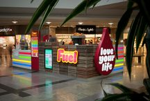 Industry: Food / Custom signage, illuminated menu boxes, deli panels, menu chalkboards and promotional displays for offers.