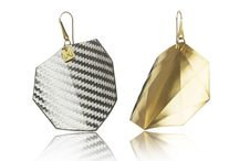 Crystal Geometry of Carbon & Metals Collection / In this collection Vanda has paired up metals and carbon fiber and through this a two-faced pendant was created: its front (on the pictures' left) was made of carbon, its back (on the pictures' right) was made of metal planes with subtle edges.