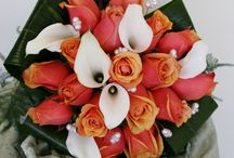 Wedding flowers / Bridal bouquet, bridesmaids and reception flowers  in a stunning combination of oranges, corals, burgundy and ivory