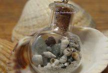 nature's charms / Small bottles filled with treasures from nature, to wear as protection and power source. Different series in the progress, here a preview