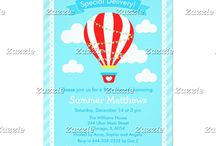 Special Delivery Hot Air Balloon Baby Shower Blue / This collection features a red hot air balloon with bunting. The background consists of clouds on sky blue, a scallop edged frame and blue stripes.