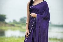 Purple Royale Pure Silk-Satin Embroidered Saree / PRICE INR 9,121/-; US$ 138.20 To buy click here https://www.eastandgrace.com/products/purple-royale-saree Featuring the Purple Royale pure silk-satin saree with hand embroidered pearl border and tree motif along a pallu end. The blouse has embroidered trees at the front. It comes with an unstitched, embroidered, blended raw-silk blouse piece which has embroidered trees at the front and an unstitched matching lycra-satin petticoat fabric. Reach us: care@eastandgrace.com
