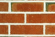 Coppertone   Triangle Brick Company / With a rocky texture and hues in shades of red and black, Triangle Brick Company's Coppertone brick tells a story of permanence and grandeur. Commercial buildings built with our Coppertone brick make a statement that lasts. This Premium-tier special production architectural brick boasts a look and feel that is unique, time-honored, and classically beautiful.